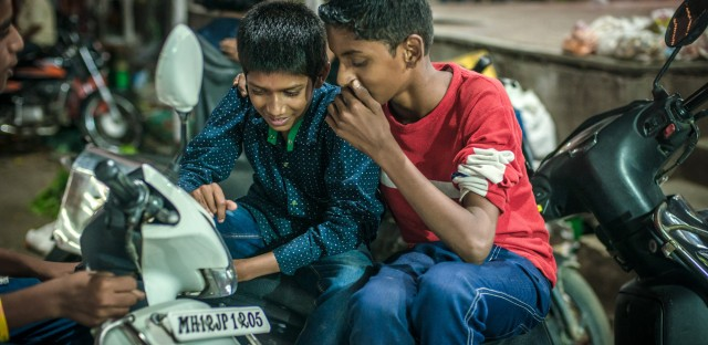 Working at the market gives Aniket a chance to catch up with his friends.