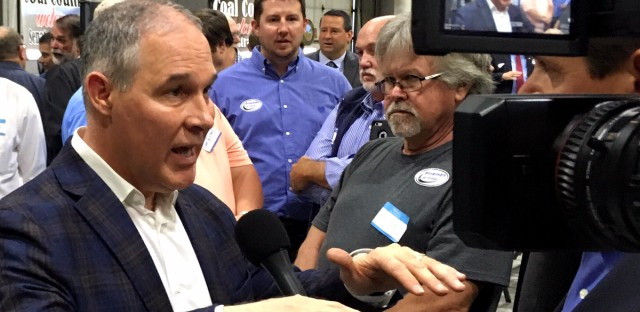 EPA Administrator Scott Pruitt talks to a reporter after speaking at Whayne Supply in Hazard, Ky on Monday, Oct. 9, 2017. Pruitt said the Trump administration will abandon the Obama-era clean power plan aimed at reducing global warming. (AP Photo/Adam Beam)