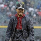 Chance the Rapper smiles after throwing out a ceremonial first pitch at a game between the Cleveland Indians and the Chicago White Sox in April.