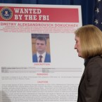 "Acting Assistant Attorney General Mary McCord walks past a ""FBI Wanted"" poster following a news conference at the Justice Department in Washington, Wednesday, March 15, 2017. The Justice Department announced charges against four defendants, including two officers of Russian security services, for a mega data breach at Yahoo. (AP Photo/Susan Walsh)"