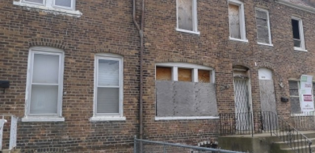 Foreclosures jump in Chicago as banks work through backlog