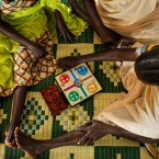 "In this Saturday, June 3, 2017 file photo, South Sudanese refugee women who suffered sexual or other gender-based violence play a board game at a women's center focusing on such violence, run by the aid group International Rescue Committee, in Bidi Bidi, Uganda. A new study released Wednesday, Nov. 29, 2017 says the ""shocking scale"" of violence against women and girls in South Sudan is double the global average."
