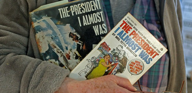 Jeanne Abel, holding the book she wrote as Yetta Bronstein, <em>The President I Almost Was.</em>