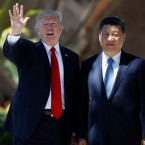 """FILE - In this Friday, April 7, 2017 file photo, President Donald Trump and Chinese President Xi Jinping pause for photographs at Mar-a-Lago in Palm Beach, Fla. when Trump was meeting again with Xi with U.S. missile strikes on Syria adding weight to his threat to act unilaterally against the nuclear weapons program of China's ally, North Korea. North Korea has vowed to bolster its defenses to protect itself against airstrikes like the ones Trump ordered against an air base in Syria. The North called the airstrikes """"absolutely unpardonable"""" and said it proves that its nuclear weapons are justified to protect the country against Washington's """"evermore reckless moves for a war."""""""