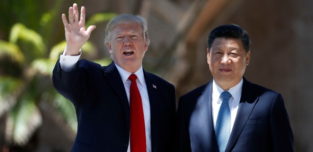 "FILE - In this Friday, April 7, 2017 file photo, President Donald Trump and Chinese President Xi Jinping pause for photographs at Mar-a-Lago in Palm Beach, Fla. when Trump was meeting again with Xi with U.S. missile strikes on Syria adding weight to his threat to act unilaterally against the nuclear weapons program of China's ally, North Korea. North Korea has vowed to bolster its defenses to protect itself against airstrikes like the ones Trump ordered against an air base in Syria. The North called the airstrikes ""absolutely unpardonable"" and said it proves that its nuclear weapons are justified to protect the country against Washington's ""evermore reckless moves for a war."""