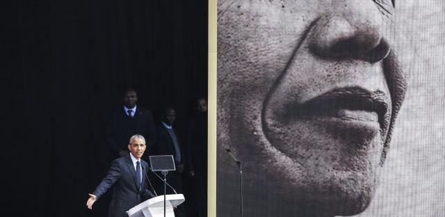 Former President Barack Obama speaks in Johannesburg on Tuesday at the centennial of Nelson Mandela's birth.