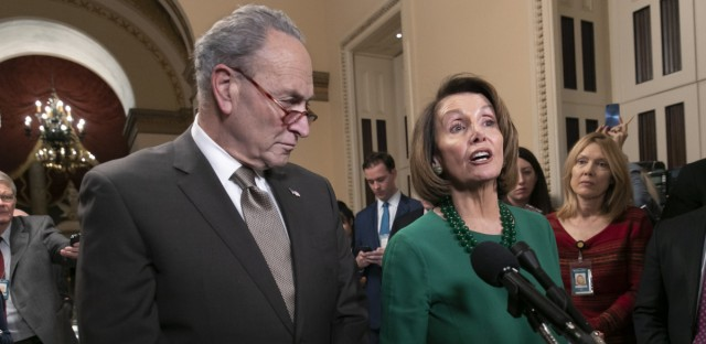 House Speaker-designate Nancy Pelosi, D-Calif., and Senate Minority Leader Chuck Schumer, D-N.Y., address reporters about the fight over funding a border wall before the partial government shutdown. Pelosi will lead House Democrats in voting on a bill to reopen the government when they take power in the House on Thursday. J. Scott Applewhite/AP