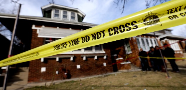 Crime scene tape surrounds a Chicago home on Feb. 7, 2016. (AP Photo/Nam Y. Huh)