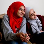 Hannah Shraim, 17, right, leans against her friend Mariam Aiyad, 16, as the girls attends a study session with their youth group from the Muslim American Society of Maryland, in Germantown, Md., Saturday, May 7, 2016.