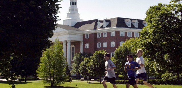 joggers run through the campus of Wheaton College in June 2003.