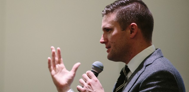 """Richard Spencer addresses a room of press and conference attendees at a news conference held by the National Policy Institute during its """"Become Who We Are"""" event in Washington, D.C. Prior to the news conference, which was held in the same room as the broader NPI event, Spencer told journalists they could not take photos of the room because attendees could be identified without their permission."""