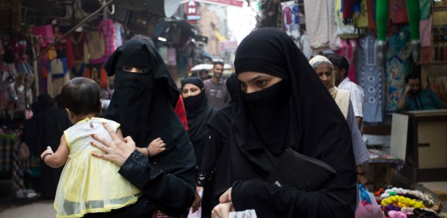 Indian Muslim women walk at a market area in New Delhi, India, Tuesday, Aug. 22, 2017. India's Supreme Court on Tuesday struck down the triple talaq Muslim practice that allows men to instantly divorce their wives as unconstitutional.