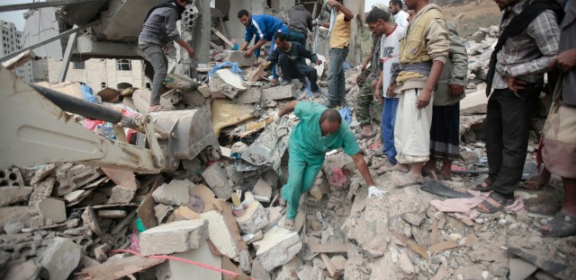 People inspect the rubble of houses destroyed by Saudi-led airstrikes in Sanaa, Yemen, Friday, Aug. 25, 2017.