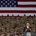 President Obama speaks to U.S. troops at Fort Bliss in El Paso, Texas, in 2012. Obama removed the large U.S. ground combat forces in Iraq and Afghanistan, as promised. But as the leaves office, the U.S. is still waging war in those two countries, as well as Syria.