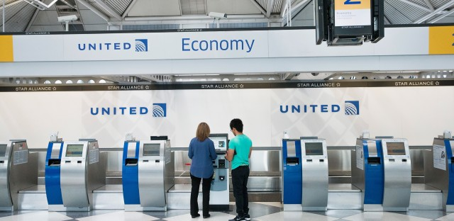 "Passengers check in for flights with United Airlines at Chicago O'Hare International Airport. United, American and Delta now offer no-frills ""basic economy"" fares."