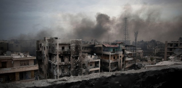 Smoke rises over Saif Al Dawla district, in Aleppo, Syria in 2012. Russia and the Syrian government will open humanitarian corridors in Syria's embattled city of Aleppo and offer a way out for opposition fighters wanting to lay down their arms, Russia's defense minister Sergei Shoigu announced last week.