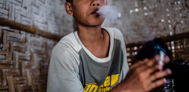 A boy has a smoke in Yogyakarta, Indonesia. (Ulet Ifansasti/Getty Images)