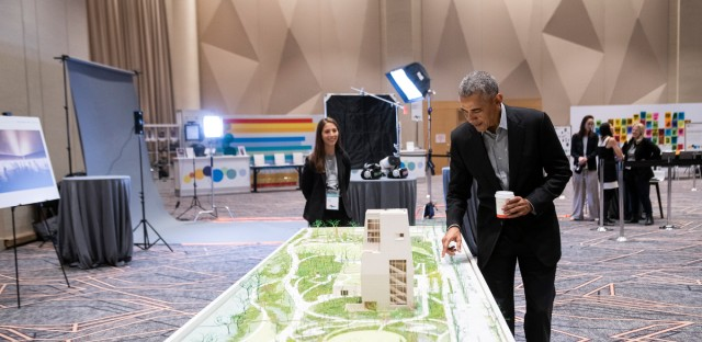 Former President Barack Obama views the Obama Presidential Center model during the Obama Foundation Summit in Chicago on Monday, Nov.19, 2018.