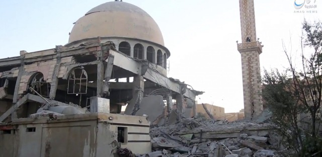 This undated frame grab from video posted online Saturday, June 10, 2017, by the Aamaq News Agency, a media arm of the Islamic State group, shows a mosque that was damaged by bombardment by the U.S.-led coalition and U.S.-backed fighters in the northern Syrian city of Raqqa. (Aamaq News Agency via AP)