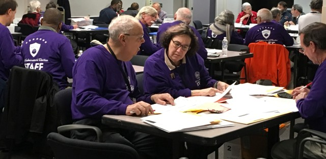 Fairfax County election workers conduct the official canvass of last night's election returns at the Fairfax County Government Center, Wednesday, Nov. 8, 2017 in Fairfax, Va.