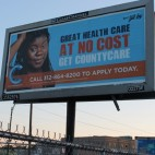 A billboard advertises CountyCare, the Cook County health system's Medicaid business.