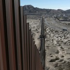 A truck drives near the Mexico-US border fence, on the Mexican side, separating the towns of Anapra, Mexico and Sunland Park, New Mexico.