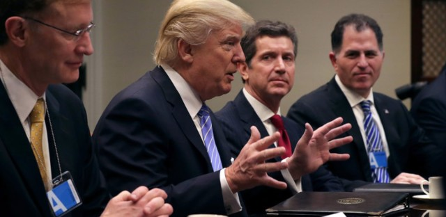 President Trump delivers opening remarks during a meeting with (left to right): Wendell Weeks of Corning, Alex Gorsky of Johnson & Johnson, Michael Dell of Dell Technologies and other other business leaders in the Roosevelt Room at the White House on Monday. (Chip Somodevilla/Getty Images)