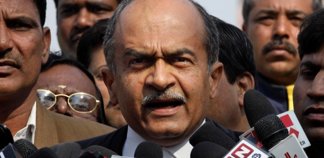 Prashant Bhushan talks to the media outside the Supreme Court, in New Delhi, India in 2012.