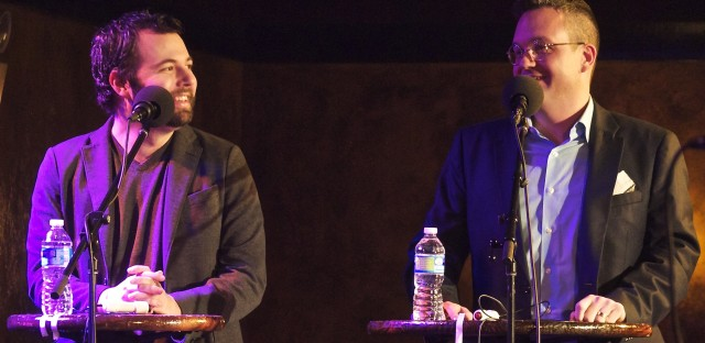 Joseph Fink (L) and Jeffrey Cranor, the creators of Welcome to Night Vale, on the Ask Me Another stage.