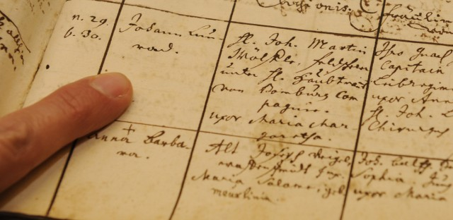 An employee points to an entry in a southern Germany parish register, which marks the ancestor of former President Barack Obama.