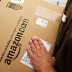 An Amazon.com package is prepared for shipment by United Parcel Service
