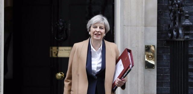Britain's Prime Minister Theresa May leaves 10 Downing Street on her way to the House of Commons in London Wednesday. May will speak to Parliament to announce that Britain is set to formally file for divorce from the European Union Wednesday, ending a 44-year relationship.
