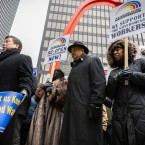 Roughly 60 federal workers and their allies, including the Rev. Jesse L. Jackson Sr., gathered at the Chicago Federal Center in downtown Chicago to protest the partial government shutdown.