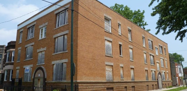 Abandoned rental buildings like this one hurt Englewood, a neighborhood on Chicago's South Side.