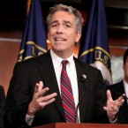 "Former Rep. Joe Walsh, R-Ill., gestures during a news conference on Capitol Hill in Washington. The former Illinois congressman and radio host is standing by a Twitter post he sent after the fatal shooting of five police officers in Dallas in which he warned President Obama to ""Watch out"" and ""Real America is coming after you."" Walsh told The Associated Press Friday, he didn't intend to incite violence against Obama or anyone else."