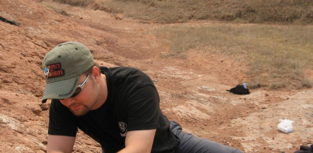 Peter Makovicky digging for dinosaur fossils.