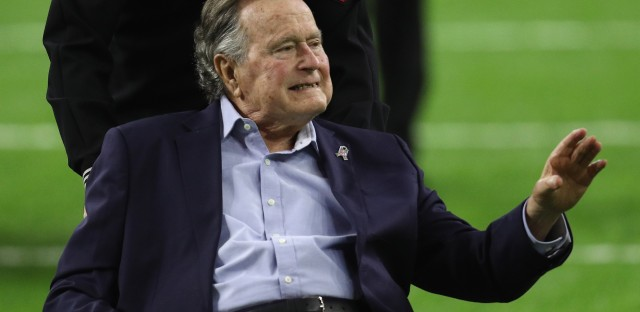 Former President George H.W. Bush arrives for the coin toss for the 2017 Super Bowl in Houston. Two women say he touched them inappropriately.