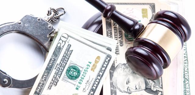 court fees money gavel handcuffs