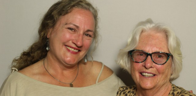 Elizabeth Heffernan talking with her daughter Laura at the StoryCorps booth at the Chicago Cultural Center.