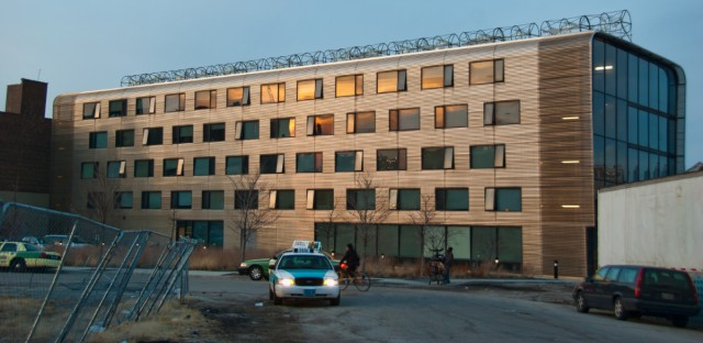 In this March 2011 photo, a cab drives through the Near North Apartments run by Mercy Housing Lakefront to provide affordable, SRO-style housing.