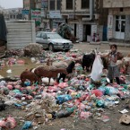 In this photo taken on Wednesday, Jul. 26, 2017, a girl scavenges for recyclable items at a garbage dump in a street in Sanaa, Yemen. Yemen's raging two-year conflict has served as an incubator for lethal cholera.