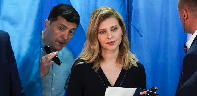 Ukrainian President Volodymyr Zelenskiy, left, and his wife Olena Zelenska leave a booth at a polling station during a parliamentary election in Kiev, Ukraine, Sunday, July 21, 2019.
