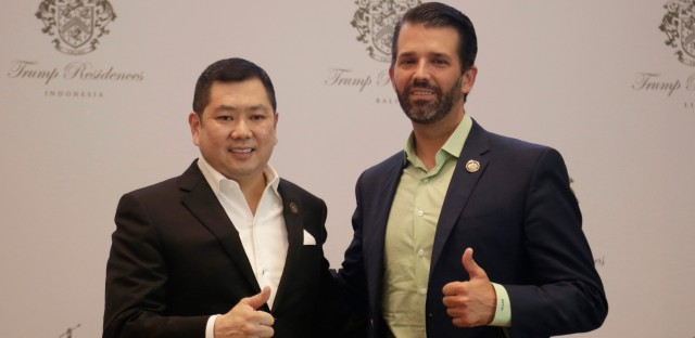 Donald Trump Jr., right, son of U.S. President Donald Trump, and Media Nusantara Citra (MNC) Group President and CEO Hary Tanoesoedibjo give thumb up sign as they pose for photographers during a press conference in Jakarta, Indonesia, Tuesday, Aug. 13, 2019. U.S. President Trump's son and his Indonesian business partner say a theme park that also features a Trump hotel and condos will no longer have Chinese financing.