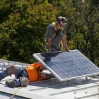 In this Oct. 16, 2015 file photo a solar panel is installed on the roof of the Old Governor's Mansion State Historic Park in Sacramento, Calif.