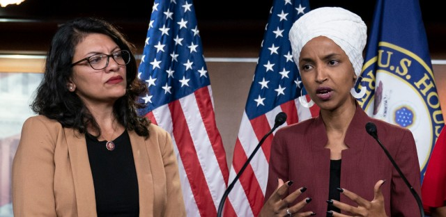 "In this July 15, 2019 file photo, U.S. Rep. Ilhan Omar, D-Minn, right, speaks, as U.S. Rep. Rashida Tlaib, D-Mich. listens, during a news conference at the Capitol in Washington. The U.S. envoy to Israel said he supports Israel's decision to deny entry to two Muslim congresswomen ahead of their planned visit to Jerusalem and the West Bank. Ambassador David Friedman said Thursday, Aug. 15, 2019, in a statement following the Israeli government's announcement that Israel ""has every right to protect its borders"" against promoters of boycotts ""in the same manner as it would bar entrants with more conventional weapons."""
