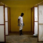 In November 2014, a worker stands by dividers to separate patients in an Ebola treatment facility under construction in the Port Loko district of Sierra Leone. David Gilkey/NPR
