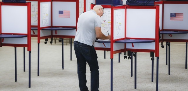 A voter fills out a ballot on the first day of early voting at the Hamilton County Board of Elections in Cincinnati, Ohio, last month. John Minchillo/AP