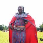 Woman Smiling in the sunlight - via Mpanzi