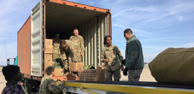 Troops load equipment as they prepare to leave Fort Campbell, Ky., on Tuesday, for deployment at the southern border.