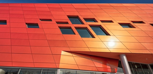 The Esperanza Health Center, located at 4700 S. California Ave., is stands outs from other buildings in the area with its bright orange, reflective facade.